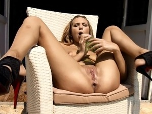 Sensational blonde with big boobs makes her peach happy with a bottle