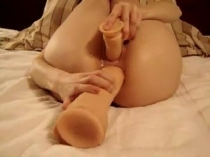 she toys her pussy and ass with 2 enormous toys