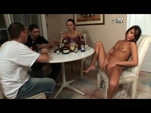 Brunette girl masturbates while card game