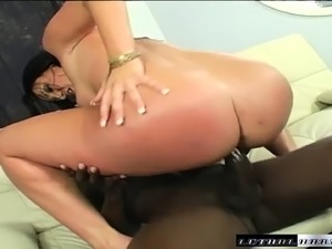 Dark-haired tart gets horny and mounts a vicious black piston