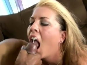 Trashy blonde mom with big tits takes a black stick in her hairy twat