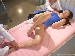The busty Japanese girl was brave enough to let three guys play with her...