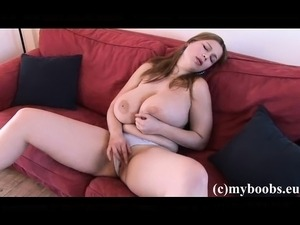 Stacked and horny redhead Terry plays with her massive tits and hot snatch on...