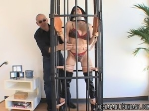 Irresistible brunette with fabulous big hooters gets tied up and caged