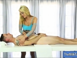 Cute blonde masseuse blowjobs hard dick under the table