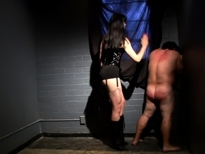 Long-haired dominatrix uses a whip to make this guy's butt turn red