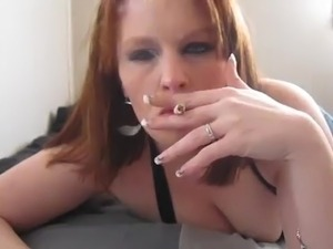 Redhead MILF chain smoking on her bed