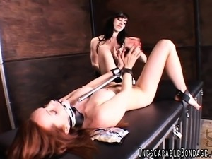 Feisty dark-haired babe enjoys playing with her hot female slave's slit