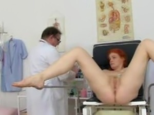 Tall redhead is thoroughly examined 2 of 2