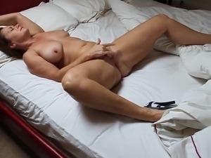 A milf in high heels masturbating