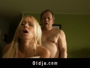 Dirty old man fucks hot young blonde in the kitchen