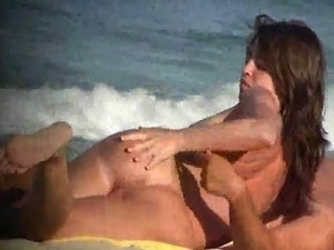 Hot nudist couple enjoying the sun and the beach.