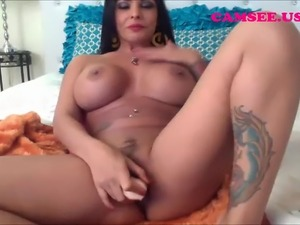 Cam; Busty latina masturbates with dildo