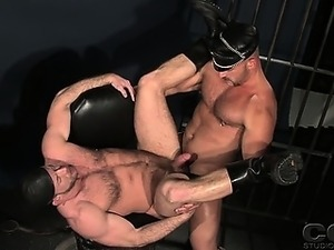 Samuel Colt and Shay Michaels in full leather gear prison
