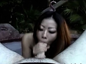 Asian pornstar in bikini smoking at pool