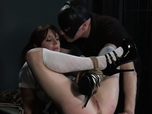 Tied up student gets spanked in dungeon