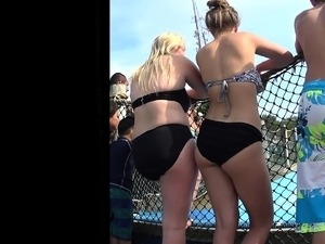 Two sexy chicks in black swimming suits get caught on camer